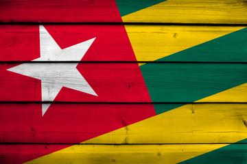 Togo Flag on wood background