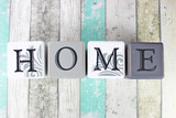 Fototapety Home sign on a distressed wooden background with turquoise tones