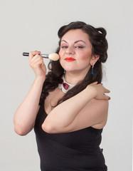Pretty brunette girl posing like Marilyn Monroe with red lips