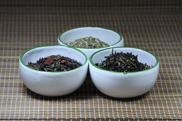 Spices in cups on a mat background