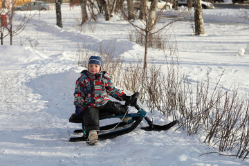 Child on a snow racer