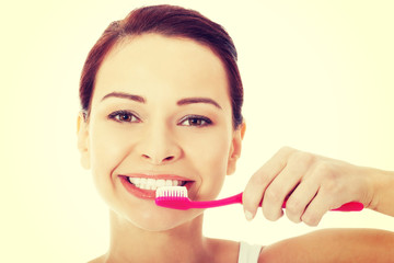 Young woman with toothbrush and paste.