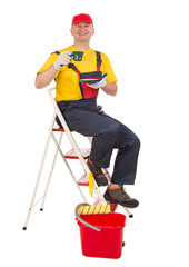 Worker on ladder with cup of tea.