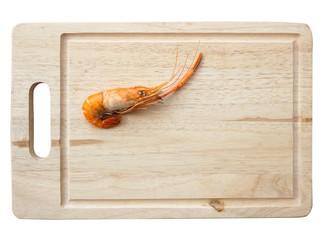 grilled shrimp on wooden plate