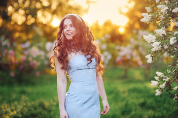 beautiful woman with long hair in the spring in the park