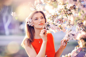 beautiful woman in a lush garden in the spring