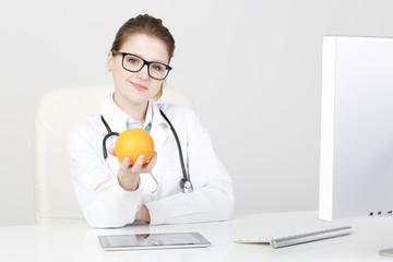 Woman Doctor Recommanding An Apple