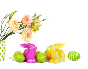 Easter eggs, bunnies and fun bouquet of flowers isolated on whit