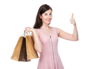Woman hold with shopping bag and finger point up