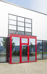 office building with red entrance