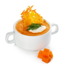 Cream of pumpkin soup with parmesan crisps isolated