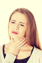 Beautiful woman is having sore throat.