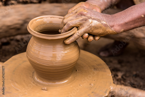 Potter making earthen pot - 76251877