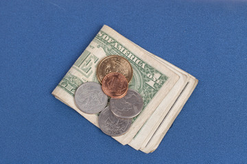 US coins on a blue notebook cover