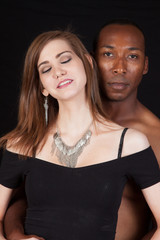Mixed racial couple in a thoughtful, romantic attitude