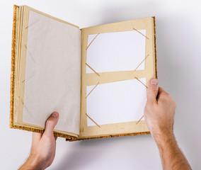 isolated photo album in hand