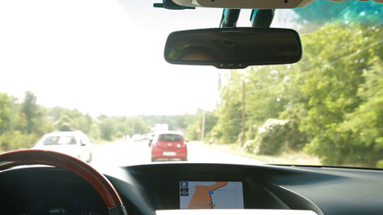 Car driving with a navigation system on the dashboard