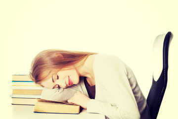 Beautiful woman is sleeping on a book.