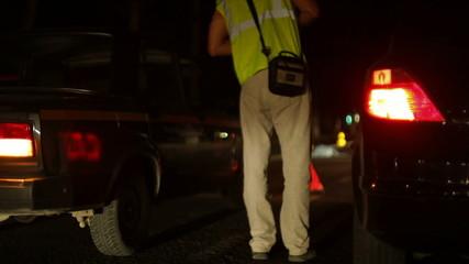 Law enforcement personnel investigate vehicle accident