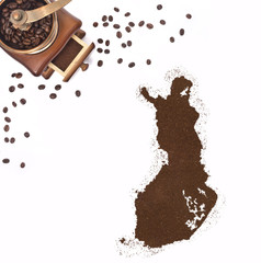 Coffee powder in the shape of Finland and a coffee mill.(series)