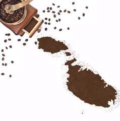 Coffee powder in the shape of Malta and a coffee mill.(series)