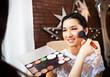Make-up artist doing make up for bride