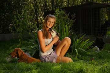 A young beautiful woman with is holding lovingly  dog