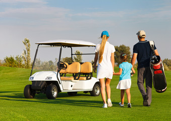 Young sportive family playing golf