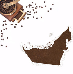 Coffee powder in the shape of United Arab Emirates and a coffee