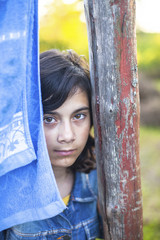 Portrait of a young girl with expressive eyes in the village.