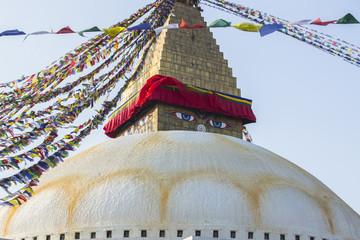 Boudhanath stupa - the symbol of Nepal, with prayer flags .