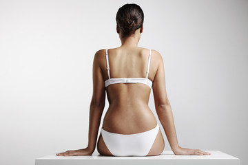 woman with a perfect body sitting on a table