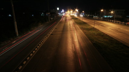 Busy Traffic at night on highway. time lapse