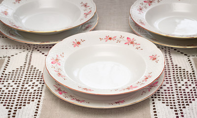 Tableware: a few white plates on the table.