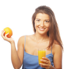 Woman holding orange and orange juice