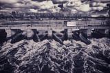 Fast Flowing Water Rushing Through a Bridge