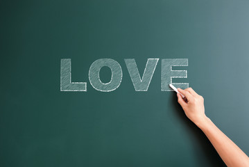 writing love on blackboard