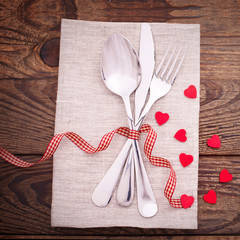 Valentines dinner on wooden background
