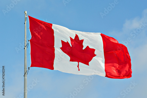 Canada Flag Flying on pole - 76262244