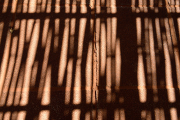 Shadow of bamboo fence on a floor