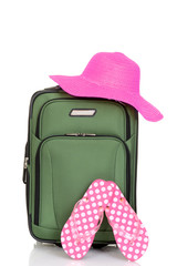 suitcase with beach hat and sandals