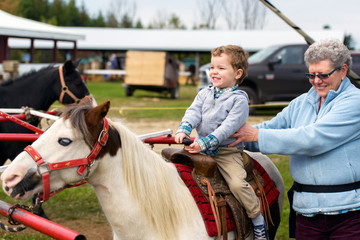 Proud Boy on his First Pony Ride