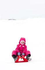sledding little girl