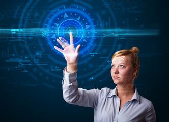 Young tech woman pressing high technology control panel screen c