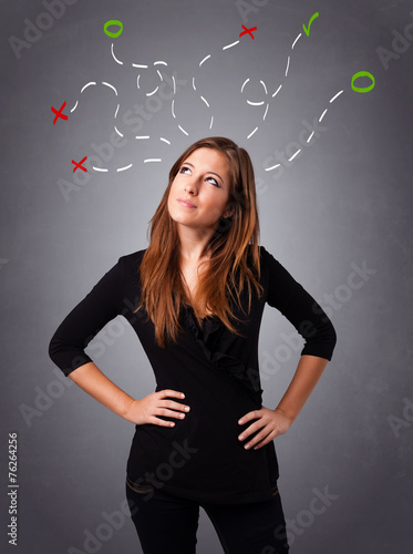 canvas print picture Young woman thinking with abstract marks overhead