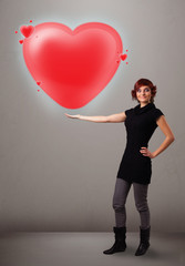 Young lady holding lovely 3d red heart