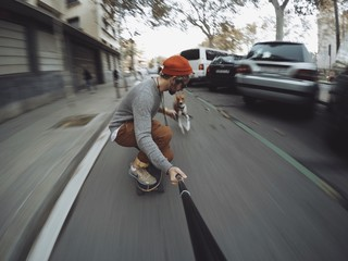 Man rides his longboard followed by his dog