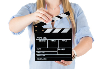 Womans hands holding a clapboard. Isolated on white