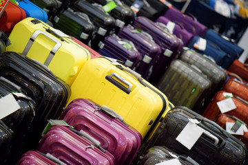 Sale of suitcases of different sizes and colors