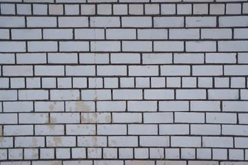 Стена из белых кирпичей